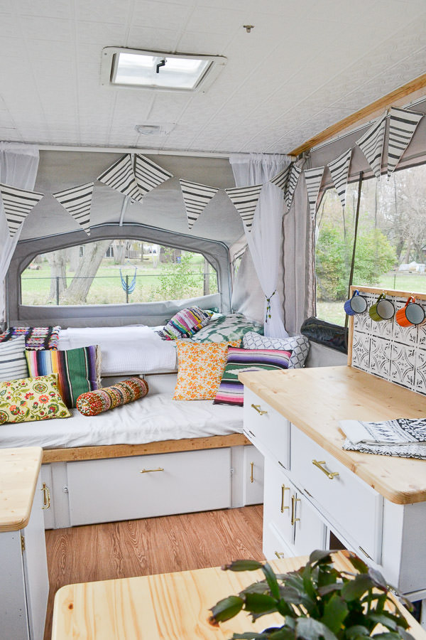 remodeled-pop-up-camper-rv-with-vintage-boho-electic-design-new-ceiling-counters-painted-cabinets-table-and-backsplash-10-of-10